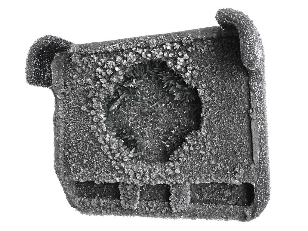 'FU FO FO', 2012, geprägter Dämmstoff, Kohlenstoff, Ammoniumphosphat, Polymer, 56x45x22 cm